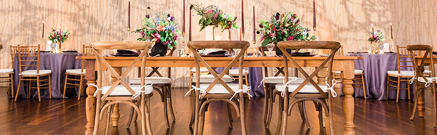 Rustic Cross Back Chairs with Cushions at Reclaimed wood farm table