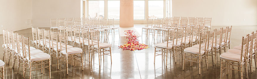 champagne chiavari chairs with ivory cushions