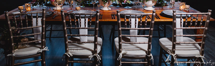 farm table with champagne chiavari chairs